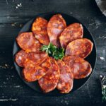 Chorizo Iberico sliced and in a plate