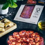 Sliced chorizo iberico in package and plate