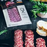 Salchichon Iberico in package and sliced